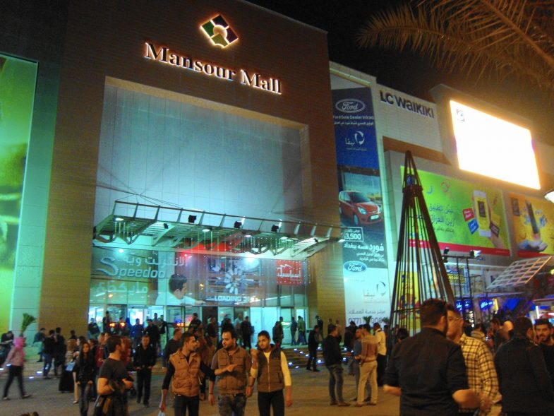 Customers at Mansour Mall in Baghdad, Iraq must file past armed guards in camouflage, separate male and female pat-down rooms and metal detectors before reaching off-brand fast food purveyors including Subz, Pizzarro and Krunchy Fried Chicken.
